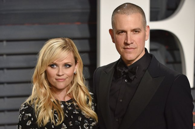 Reese Witherspoon (L) and her husband, Jim Toth, will be executive producing the 2021 Stand Up to Cancer special. File Photo by Christine Chew/UPI