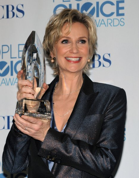 Jane Lynch, winner of the favorite comedy series actress award for Glee, poses backstage with the award at the People's Choice Awards in Los Angeles on January 5, 2011.UPI/Jim Ruymen