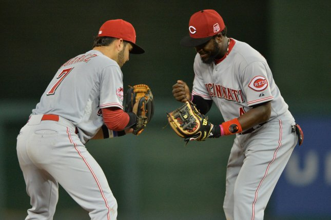 Cincinnati Reds Eugenio Suarez (7) and Brandon Phillips play rock paper scissors after the Red defeated the Washington Nationals 3-2, at Nationals Park in Washington, D.C. on July 6, 2015. Photo by Kevin Dietsch/UPI
