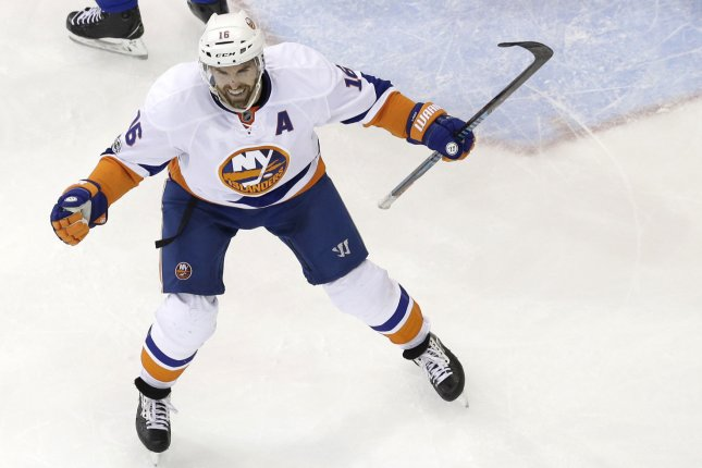 Andrew Ladd scored a power-play goal with 7:22 remaining in the third period as the Islanders rallied for a crucial 3-2 victory over the New York Rangers. File Photo by John Angelillo/UPI