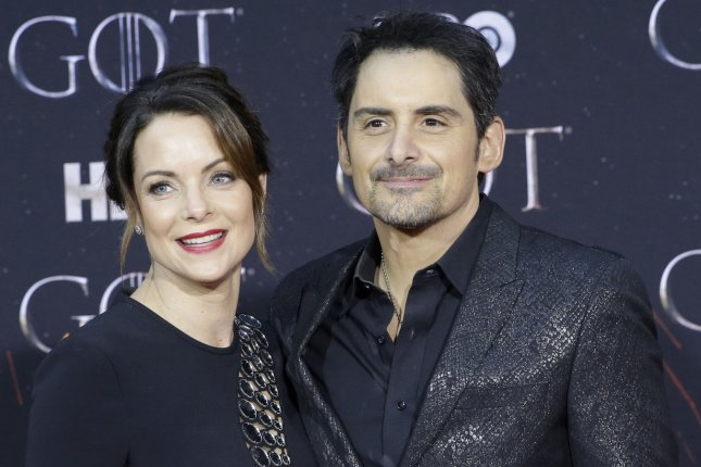 Brad Paisley (R) and his wife Kimberly Williams Paisley arrive at the Season 8 premiere of Game of Thrones in April 2019. File Photo by John Angelillo/UPI