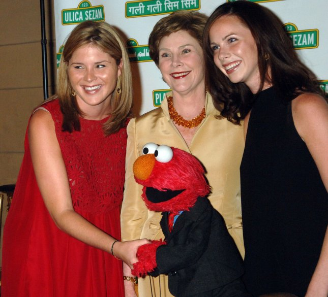 First Lady Laura Bush (C) and her daughters Jenna and Barbara (L to R) are greeted by Elmo at the 5th annual Sesame Street Workshop gala in New York on May 30, 2007. The event honored the First Lady for her work in promoting early literacy. (UPI File Photo/Ezio Petersen)