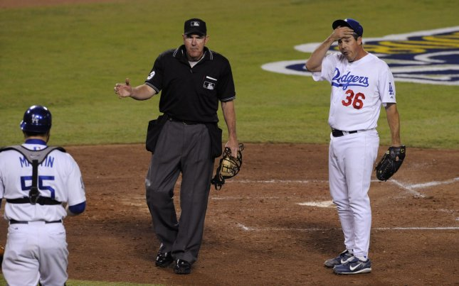 Los Angeles Dodgers' pitcher Greg Maddux (R) reacts after the Philadelphia Phillies scored on a wild throw to home during the fifth inning of Game 5 of the National League Championship Series in Los Angeles on October 15, 2008. (UPI Photo/Phil McCarten)