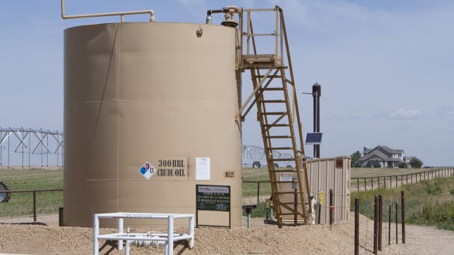 A oil pumping and storage unit sits at the beginning of a long driveway of a rural farm home at the Niobrara oil shale formation in Weld County, North eastern Colorado on May 30, 2012. Gas and oil companies are using large amounts of water to obtain shale oil and gas in a process called hydraulic fracturing or fracking. UPI/Gary C. Caskey