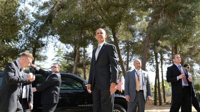 U.S. President Barack Obama pauses as the Secret Service provides security during a visit to Mount Herzl on the west side of Jerusalem, Israel on March 22, 2013. Mount Herzl is Israel's national cemetery and is named after Theodor Herzl, who was the founder of the modern Zionist movement. Obama is in the final day of his three-day visit to Israel and the Palestinian Territories. UPI/Kobi Gideon/GPO