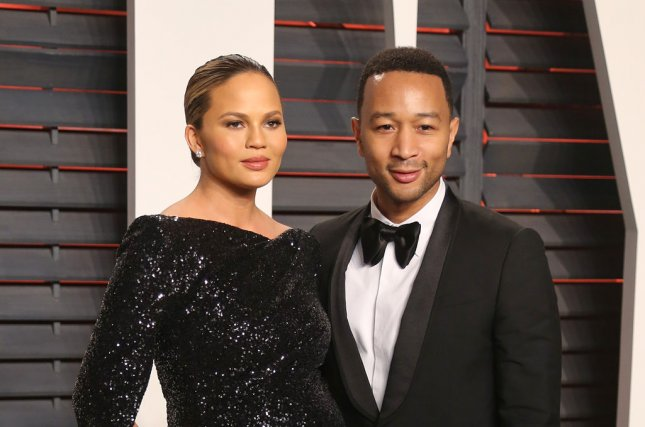 Chrissy Teigen (L) and John Legend at the Vanity Fair Oscar party on February 28. The model gave birth to a daughter in April. File Photo by David Silpa/UPI