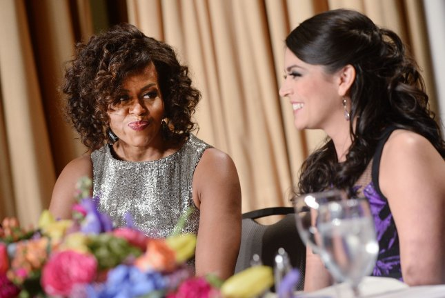 Saturday Night Live comedian Cecily Strong speaks with First Lady Michelle Obama at the annual White House Correspondent's Association Gala at the Washington Hilton hotel on April 25, 2015 in Washington, D.C. Pool photo by Olivier Douliery/UPI