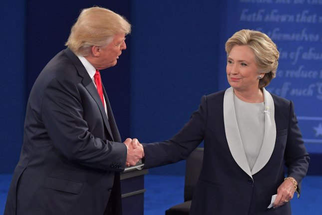 Donald Trump and Hillary Clinton shake hands after the presidential debate at Washington University in St. Louis on October 8. During the debate, Trump said he would appoint a special prosecutor to investigate Clinton if he became president. On Tuesday, an aide said he would not. File Photo by Kevin Dietsch/UPI