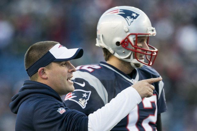 New England Patriots offensive coordinator Josh McDaniels and quarterback Tom Brady (12) go through warmups before facing the Kansas City Chiefs in the AFC Divisional Playoff game at Gillette Stadium in Foxborough, Massachusetts on January 16, 2016. Photo by Kelvin Ma/ UPI
