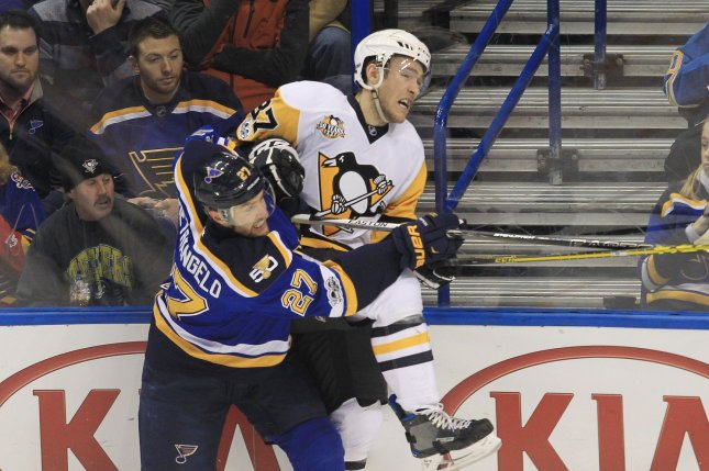 St. Louis Blues Alex Pietrangelo checks Pittsburgh Penguins Sidney Crosby into the boards in the first period at the Scottrade Center in St. Louis on February 4, 2017. Photo by Bill Greenblatt/UPI