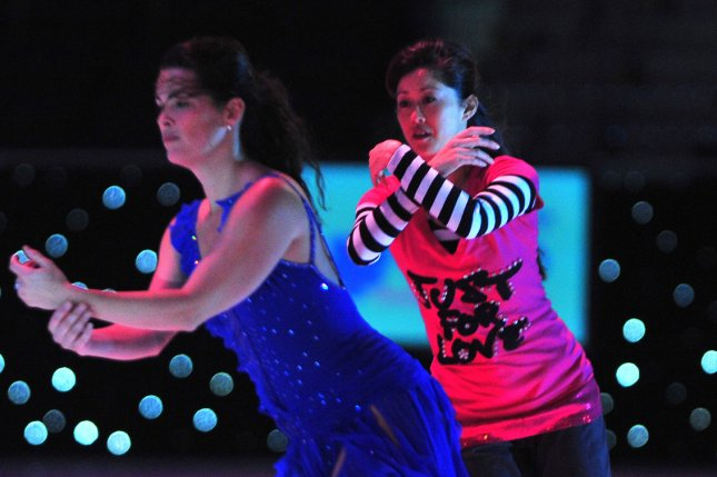 Olympic skating medalist Kristi Yamaguchi (R) and Nancy Kerrigan perform during a practice for Kaleidoscope, at the Verizon Center in Washington. UPI/Kevin Dietsch