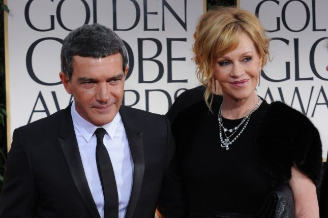 Antonio Banderas (L), pictured with Melanie Griffith, voiced his love for the actress in a new interview. File Photo by Jim Ruymen/UPI