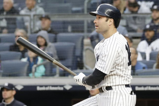 New York Yankees' Neil Walker hits a walk off game winning RBI single in the 11th inning against the Oakland Athletics on Saturday at Yankee Stadium in New York City. Photo by John Angelillo/UPI