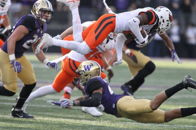 Former Oregon State Beavers wide receiver and current San Francisco 49ers wide out Victor Bolden Jr. (6) goes airborne after being hit by Washington Huskies defensive back Sidney Jones (26) during the first quarter on October 22, 2016 at Husky Stadium in Seattle. File photo by Jim Bryant/UPI