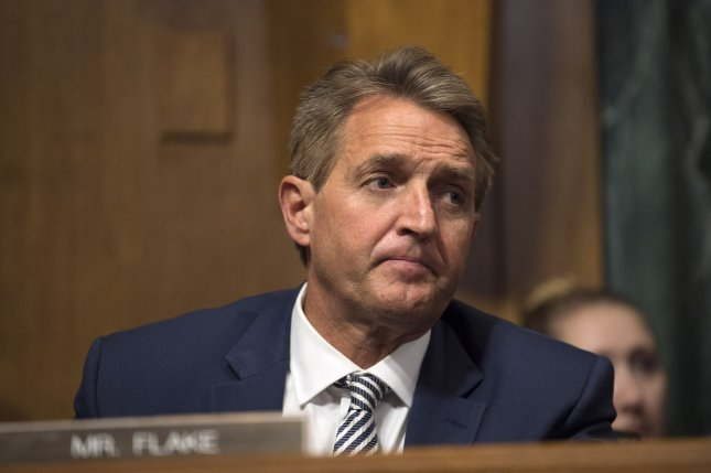 Sen. Jeff Flake, R-Ariz., listens as the Senate Judiciary Committee meets to debate the nomination of Supreme Court Justice nominee Brett Kavanaugh on Friday. Photo by Kevin Dietsch/UPI