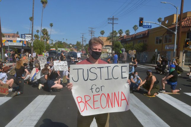 Protesters stop traffic on Sunset Boulevard in Los Angeles to express outrage at police brutality on Friday. This week, Louisville, Ky., Mayor Greg Fischer signed an ordinance that bans no-knock warrants like the one police were executing when they shot 26-year-old Breonna Taylor in March. Photo by Jim Ruymen/UPI