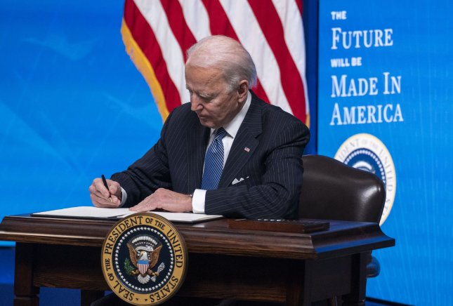 President Joe Biden signs an executive order related to American manufacturing and American workers, at the Eisenhower Executive Office Building in Washington, D.C. on Monday. Photo by Kevin Dietsch/UPI