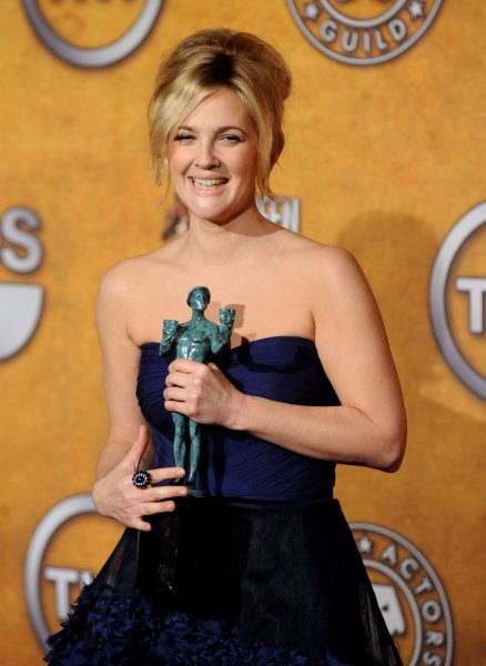 Drew Barrymore appears backstage with her award for best female actor in a TV movie or miniseries for her work in Grey Gardens, at the 16th annual Screen Actors Guild Awards in Los Angeles, Jan. 23, 2010. UPI/Jim Ruymen