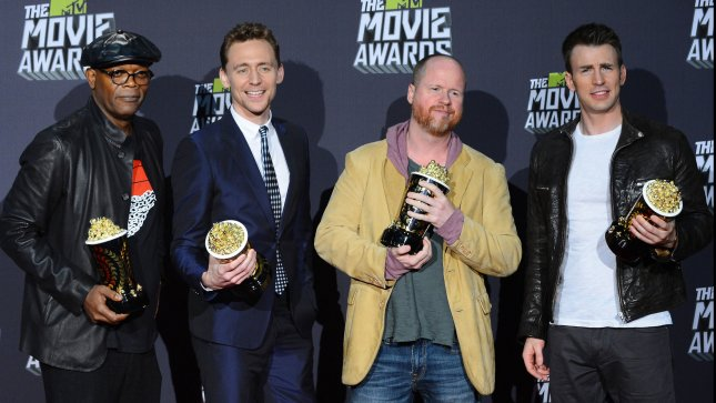 Actors Samuel L. Jackson and Tom Hiddleston, director Joss Whedon, and actor Chris Evans (L-R), winners of Movie of the Year award for Marvel's The Avengers,, appear backstage in the press room during the MTV Movie Awards in Culver City, California on April 14, 2013. UPI/Jim Ruymen