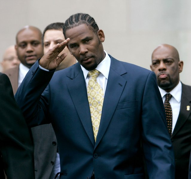 R&B star R. Kelly waves to supporters as he leaves Cook County criminal court after being acquitted on all counts in his child-pornography trial in Chicago on June 13, 2008. (UPI Photo/Brian Kersey)