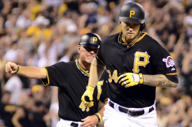Pittsburgh Pirates starting pitcher A.J. Burnett (34) runs home after celebrating with Pittsburgh Pirates third base coach Rick Sofield (41) following his solo home run in the fifth inning against the St. Louis Cardinals at PNC Park in Pittsburgh, on July 11, 2015. Photo by Archie Carpenter/UPI