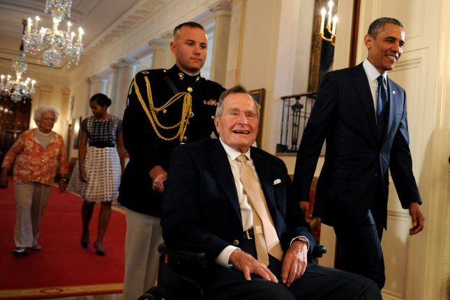 U.S. President Barack Obama walks with former President George H.W. Bush to the East Room of the White House to present the 5,000th award from Bush's Points of Light Foundation in Washington, DC on July 15, 2013. The 41st President was released from a medical facility in Maine on July 19, 2015, after suffering a spinal neck injury the prior week. File photo by Pat Benic/UPI
