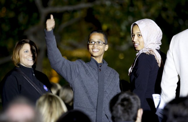 Ahmed Mohamed, left, who was arrested when he brought a homemade clock to school in Irving, Texas, takes part in the second White House Astronomy Night hosted by President Barack Obama on Monday on the South Lawn of the White House in Washington, D.C. Pool photo by Aude Guerrucci/UPI