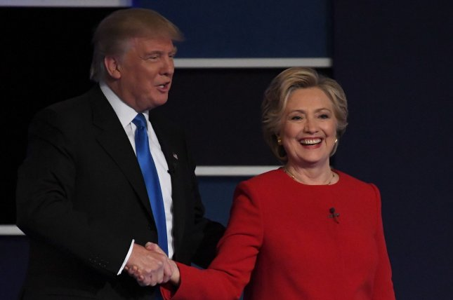 Donald Trump and Hillary Clinton greet each other after the first presidential debate at Hofstra University in Hempstead, N.Y., on Sept. 26. Trump leads Clinton by 0.64 percent in the latest UPI/CVoter daily presidential tracking poll. Photo by Pat Benic/UPI