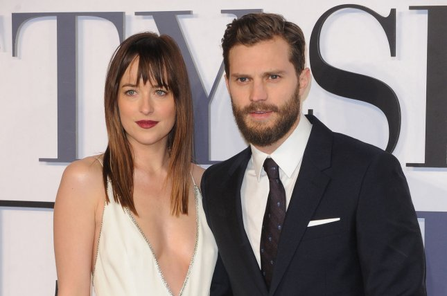 Dakota Johnson (L) and Jamie Dornan at the London premiere of Fifty Shades of Grey on February 12, 2015. File Photo by Paul Treadway/UPI