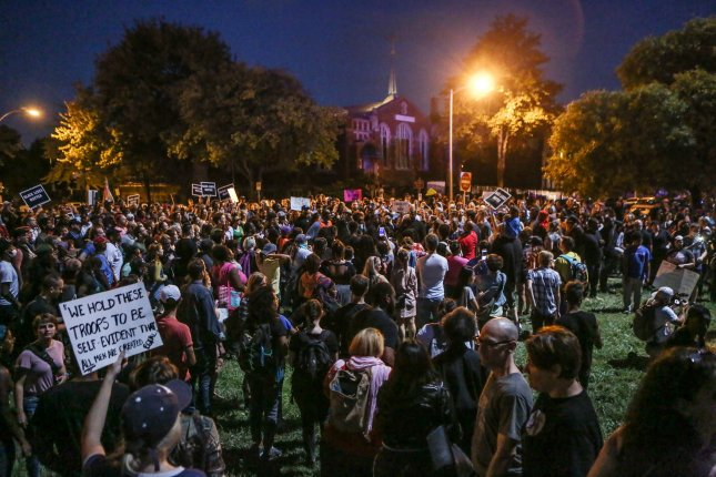 Protesters chant as they walk through the streets of St. Louis following in the early evening, hours after the announcement of a non-guilty verdict of a former white St. Louis policeman in the 2011 shooting of a black man, in St. Louis on September 15. Jason Stockley was acquitted of first degree murder charges in the fatal shooting of Anthony Lamar Smith on December 11, 2011 following a high-speed chase. Police arrested over 30 protesters for minor offensives. Photo by Lawrence Bryant/UPI