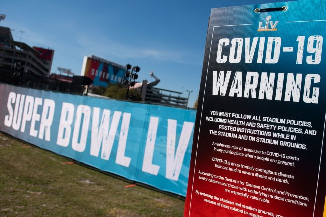 A COVID-19 warning sign is seen outside of Raymond James Stadium prior to Super Bowl LV in Tampa, Fla. Photo by Kevin Dietsch/UPI