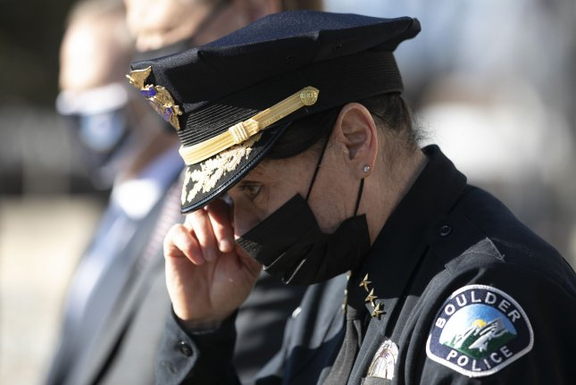 Boulder Police Chief Maris Herold wipes her eye at a press conference on Tuesday to discuss the shooting deaths of 10 people, including a police officer, at a King Soopers grocery store in Boulder, Colo. Photo by Bob Strong/UPI