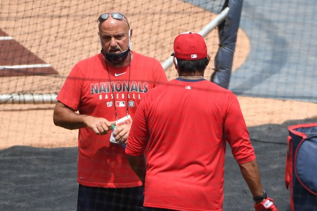 Washington Nationals general manager Mike Rizzo (L) didn't disclose who tested positive for COVID-19. The positive result came from a test conducted Monday. File Photo by Kevin Dietsch/UPI