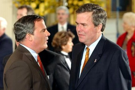 In better days, then-Connecticut Gov. John Rowland, R, chats with then-Florida Gov. Jeb Bush during a governors' meeting at the White House. Rowland was convicted Friday for a second time of federal charges. mk/Michael Kleinfeld/UPI
