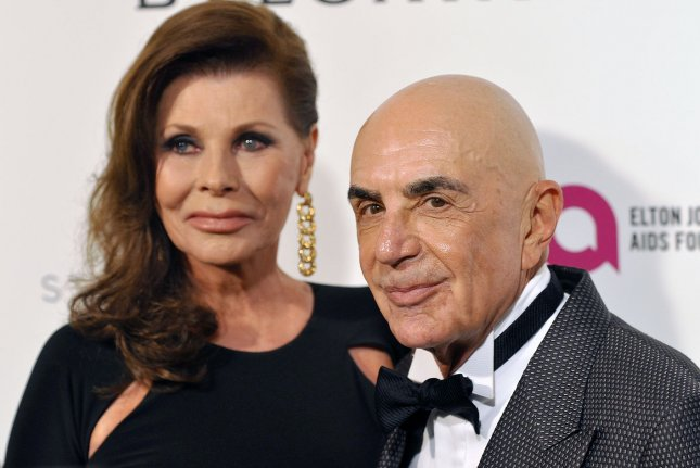 Lawyer Robert Shapiro and his wife Linell arrive at the Elton John Aids Foundation's 24th Annual Academy Awards viewing party on February 28, 2016. Shapiro revealed what he says former client O.J. Simpson whispered into his ear after receiving his not guilty verdict. File Photo by Christine Chew/UPI