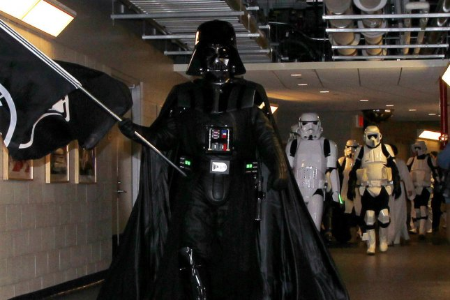 Darth Vader, seen here before a meet and greet with fans before the New York Mets play the Washington Nationals at Citi Field in New York City in 2012, will be featured heavily in Rogue One: A Star Wars Movie. File Photo by John Angelillo/UPI