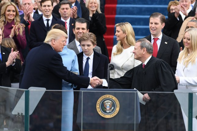 President Donald Trump shakes hands with Chief Justice John Roberts after taking the oath of office at his inauguration on Friday in Washington, D.C. According to a Gallup poll, 39 percent of Americans say they are more hopeful about the next four years based on what they saw, heard or read about the inauguration. Photo by Pat Benic/UPI