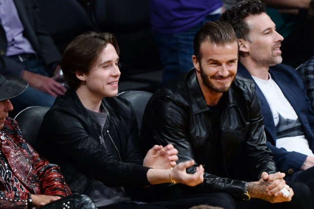 Former professional soccer player David Beckham and his son Brooklyn sit court side as they attend Kobe Bryant's final game as a Los Angeles Laker in 2016 at the Staples Center in Los Angeles, Calif. File photo by Jim Ruymen/UPI