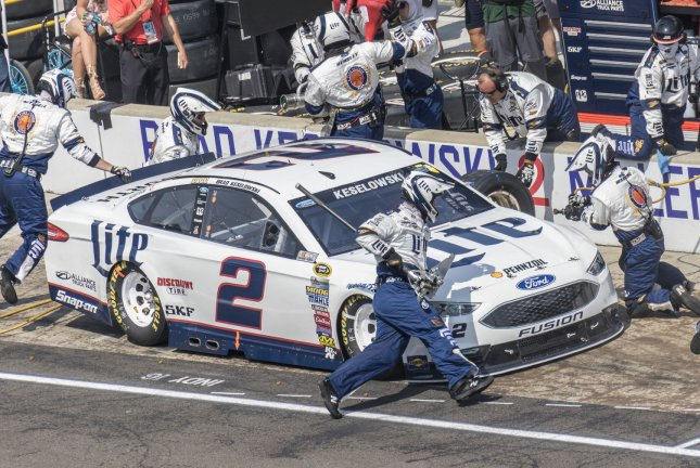 The nearly acrobatic crew of Brad Keselowski's Miller Lite Ford (2) work during second pit for him during the 23rd Brickyard 400 at the Indianapolis Motor Speedway on July 24, 2016 in Indianapolis, Indiana. File photo by Ed Locke/UPI