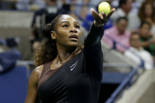 Serena Williams serves in her first round match victory over Magda Linette of Poland in Arthur Ashe Stadium at the 2018 U.S. Open Tennis Championships on Monday at the USTA Billie Jean King National Tennis Center in New York City. Photo by John Angelillo/UPI