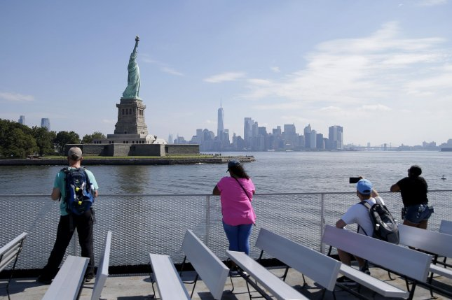 Sightseers space out aboard a Statue Cruises boat on route to The Statue of Liberty. Social distancing is the most effective way to slow COVID-19 spread, a new study has found. Photo by John Angelillo/UPI
