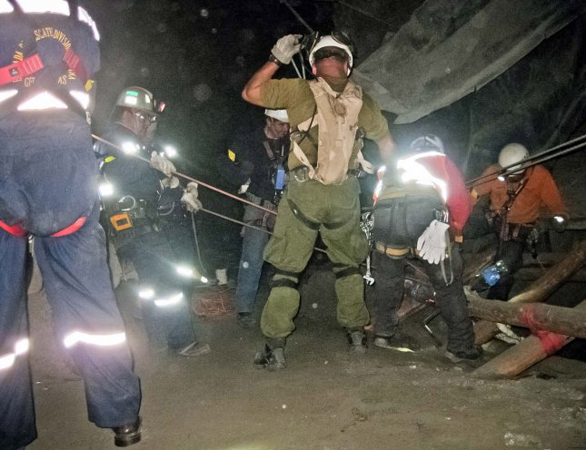 Rescuers try to make contact with the 33 miners trapped inside the San Jose mine near Copiapo, Chile on August 7, 2010. They were forced to turn back after a ventilation shaft collapsed. The miners were finally contacted on August 22 and are alive but rescue may be months away. UPI