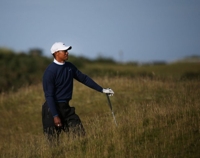 American Tiger Woods stands in the rough on the 16th hole at the 144th Open Championship, St. Andrews, on July 18. could return to golf from injury within a week. File photo by Hugo Philpott/UPI