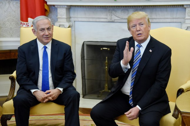 President Donald Trump speaks as Prime Minister Benjamin Netanyahu of Israel looks on in the Oval Office of the White House in Washington, D.C., on Monday. Photo by Olivier Douliery/UPI