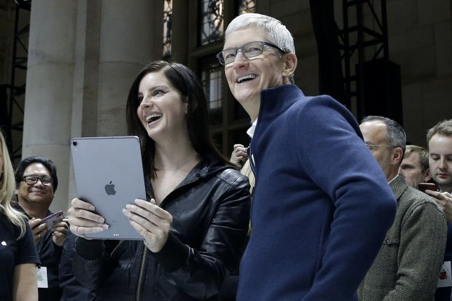 Lana Del Rey (L) and Apple CEO Tim Cook test the new Apple iPad at an Apple Special Event at the Brooklyn Academy of Music in New York City on Tuesday. Photo by John Angelillo/UPI