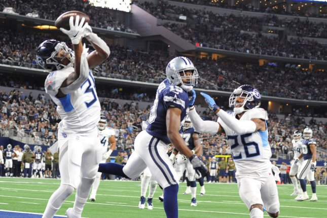 Tennessee Titans safety Kevin Byard (L) intercepts a Dak Prescott pass in the end zone for a touchback during the first half on Monday night at AT&T Stadium in Arlington, Texas. Photo by Ian Halperin/UPI
