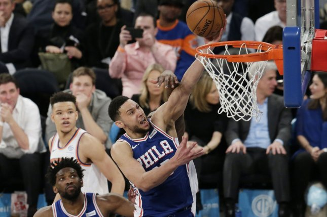 Philadelphia 76ers guard Ben Simmons and Milwaukee Bucks star Giannis Antetokounmpo exchanged dunks on each other in the fourth quarter Sunday in Milwaukee. Photo by John Angelillo/UPI