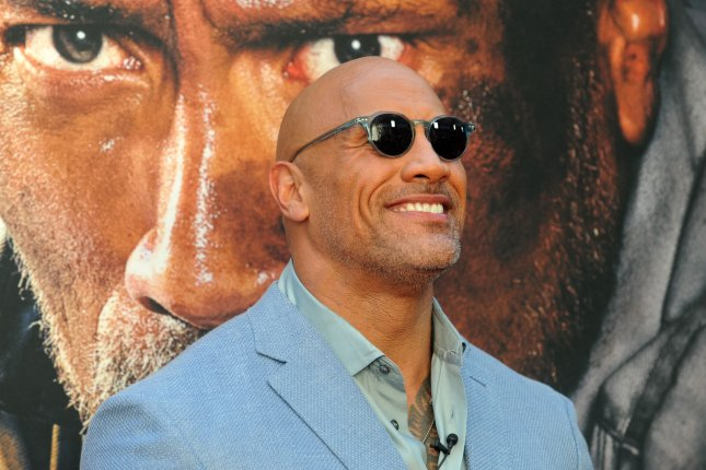 Dwayne Johnson ripped a malfunctioning security gate out of a wall at his home Friday when it prevented him from leaving for work. File Photo by Dennis Van Tine/UPI