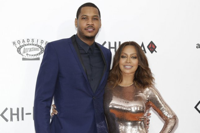 La La Anthony (R) and Carmelo Anthony arrive on the red carpet at the premiere of Chi-Raq in December 2015. La La Anthony has filed for divorce. File Photo by John Angelillo/UPI