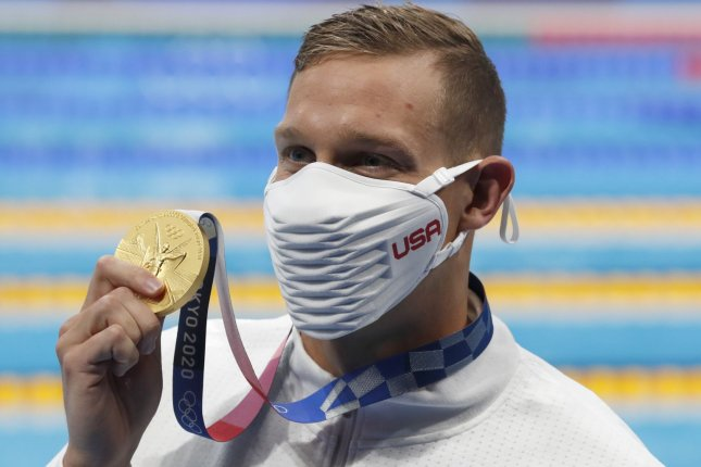 Team USA's Caeleb Dressel celebrates his gold medal from the men's 50-meter freestyle swimming final at the 2020 Summer Games on Sunday in Tokyo. Photo by Tasos Katopodis/UPI